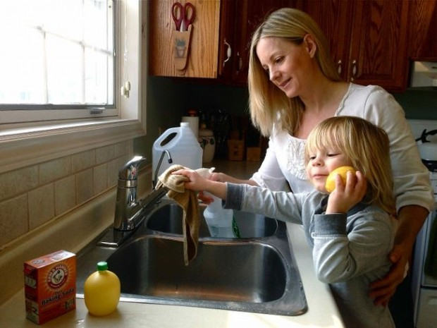 Sherry Torkos and son Phoenix at the sink.