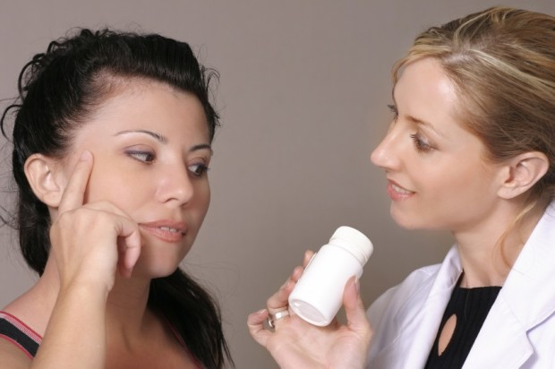 Pharmacist and woman talking about supplements