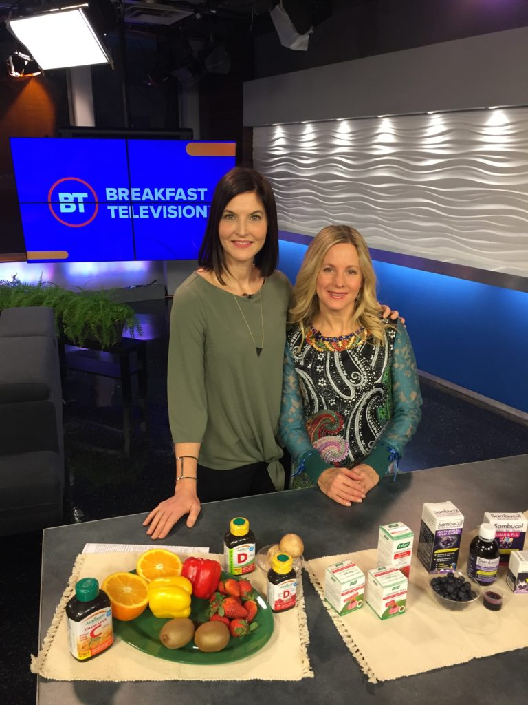 Women on TV set talking about supplements