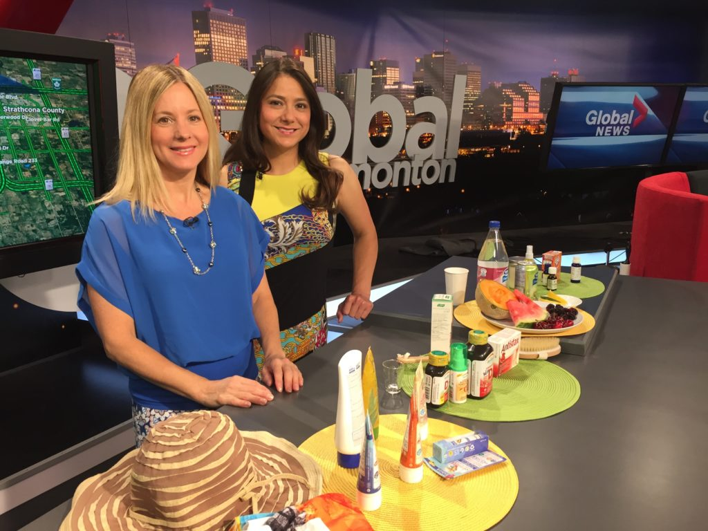 Women on TV set with table of sun products